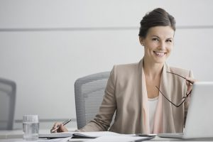 Portrait of confident businesswoman working in conference room